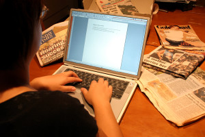 A person typing on a laptop.